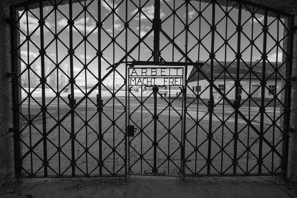 "The entrance gate of the Dachau concentration camp saying ""arbeit macht frei"""