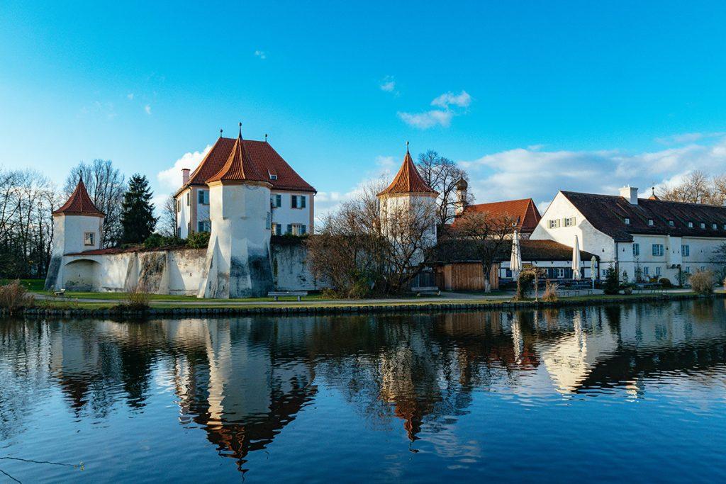 The wide water moat around Blutenburg castle in Munich