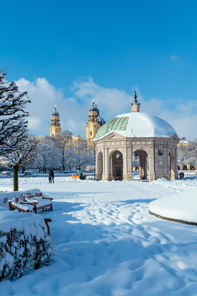 The hofgarten in Munich in Winter with the Theatinerkirche in the background