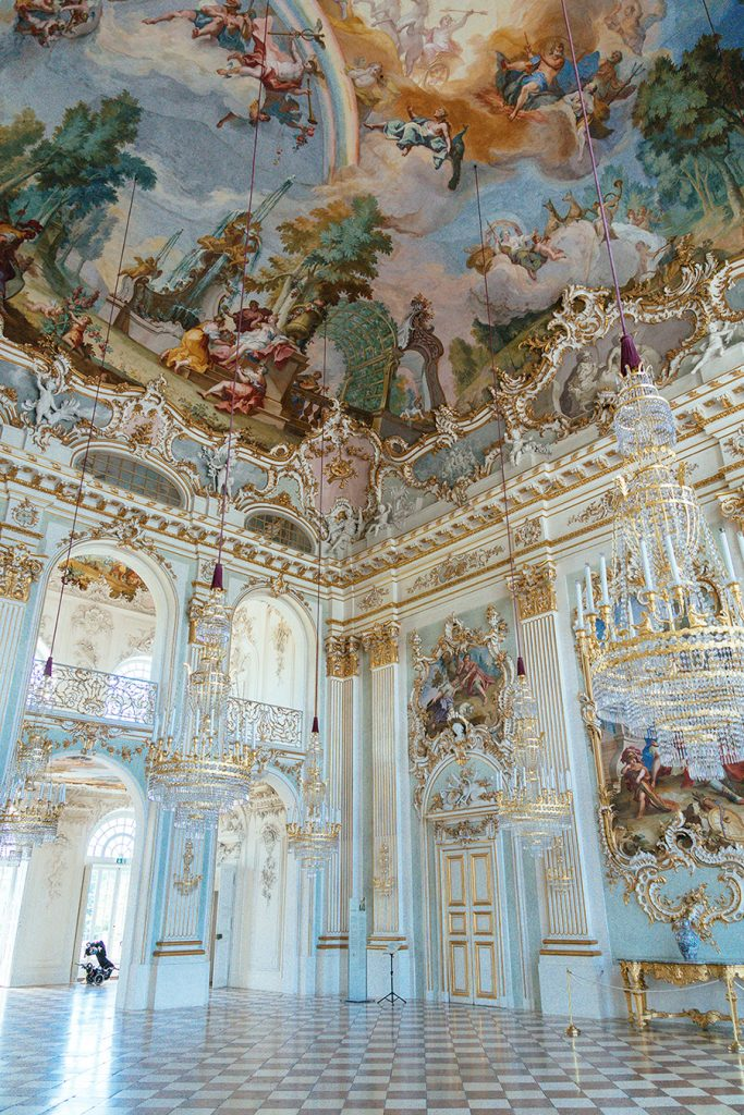 The stone haal with frescoes inside Nymphenburg Palace in Munich