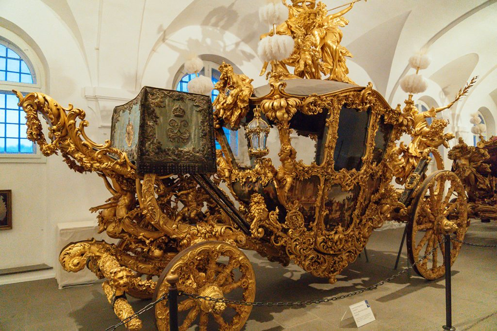 An ornate gilded coach in the Marstallmuseum in Nymphenburg munich