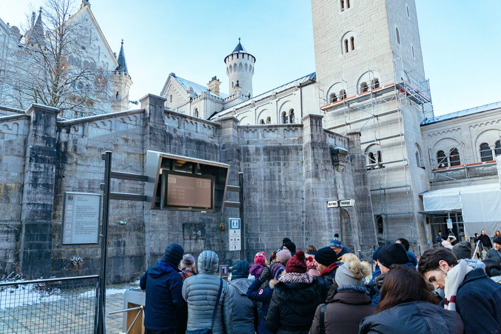 The queue in front of the entrance of Neuschwanstein castle waiting for the next tour