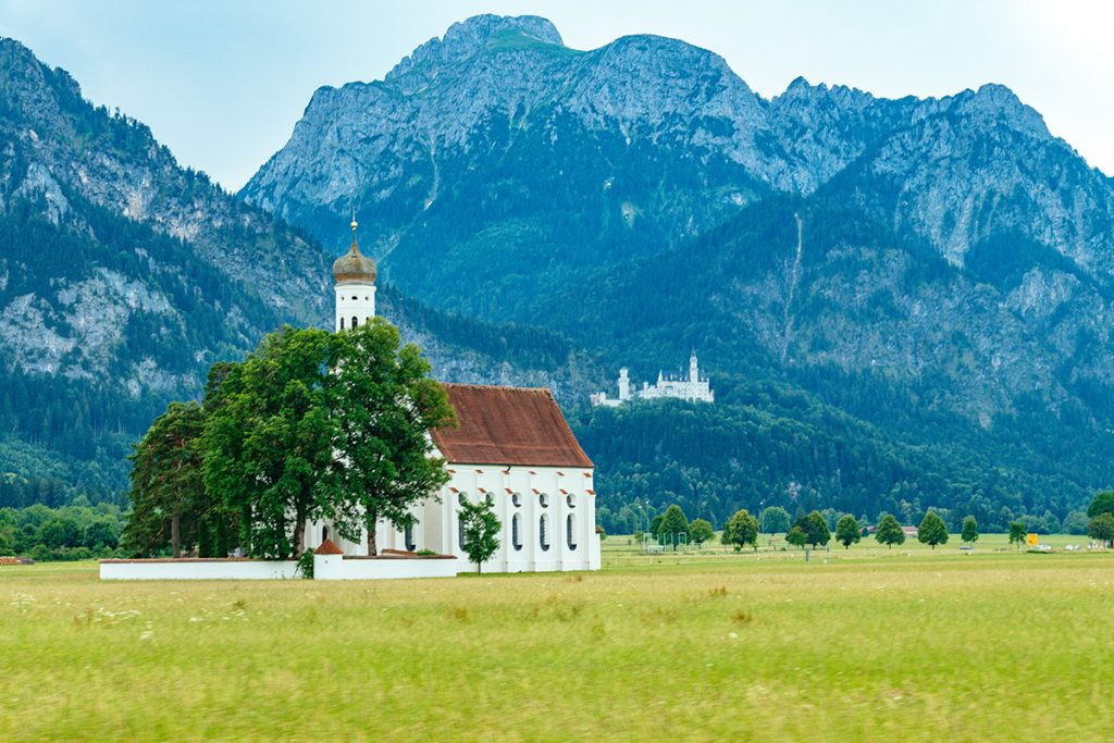 St Coloman church and Neuschwanstein castle in the background