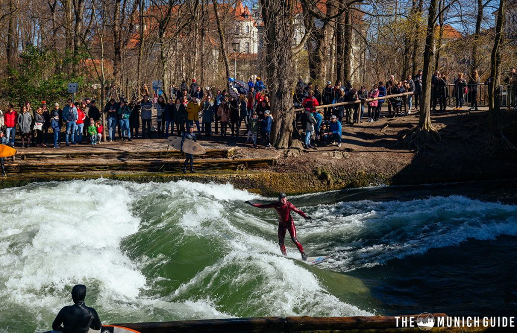 A surfer at the Eisbach stehende welle in Munich, Germany