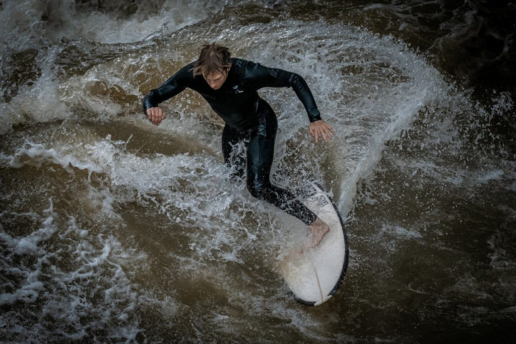 A surfer at the Eisbachwelle in Munich