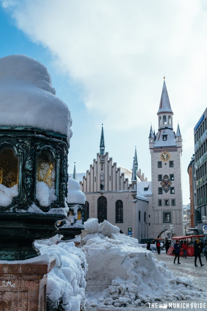 Munich's old town hall in winter covered in snow