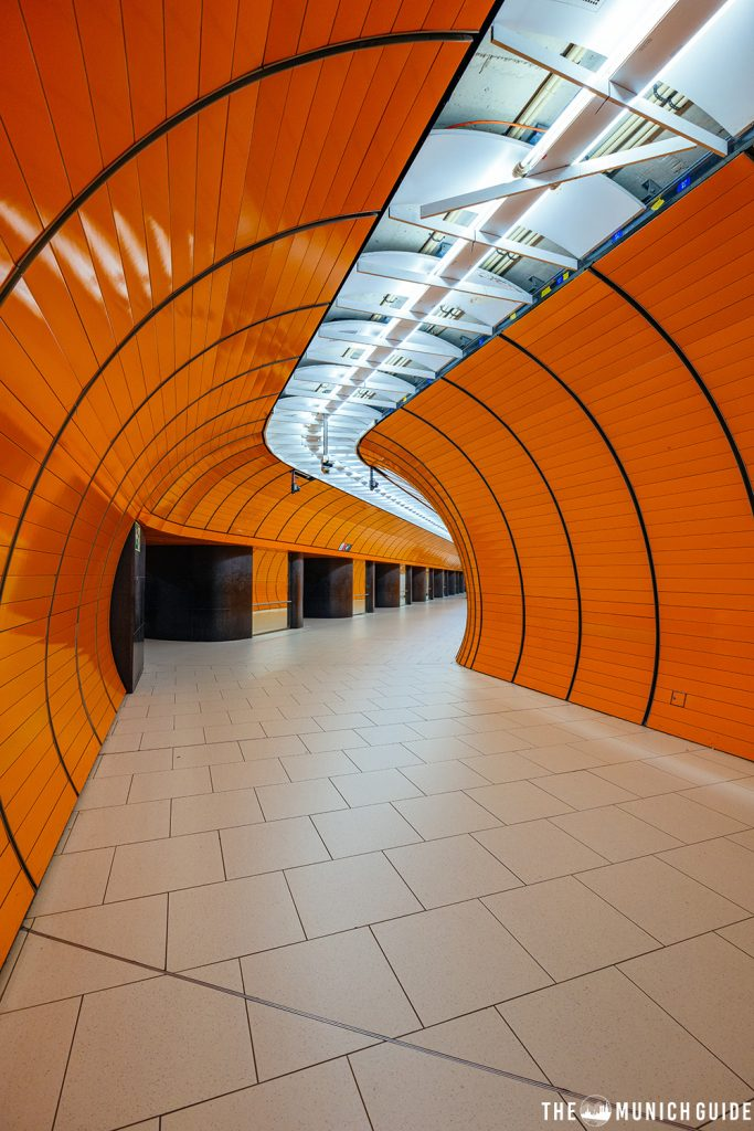 bright orange tunnels in the subway station Marienplatz in Munich, Germany