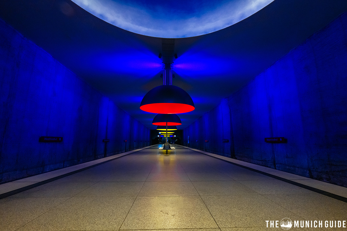 The most beautiful subway station in Munich: Westfriedhof is deep blue and hase huge lamps hanging from the ceiling